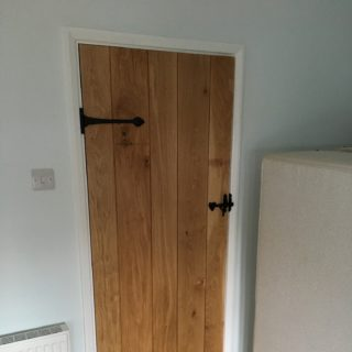 solid oak door with ironwork from for Inspire Joinery and Renovations