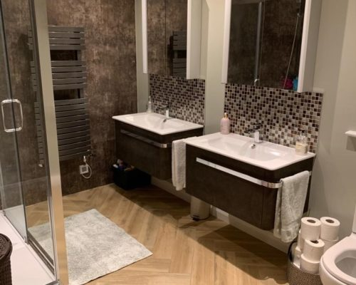 image of fitted bathroom with double sinks for Inspire Joinery and Renovations